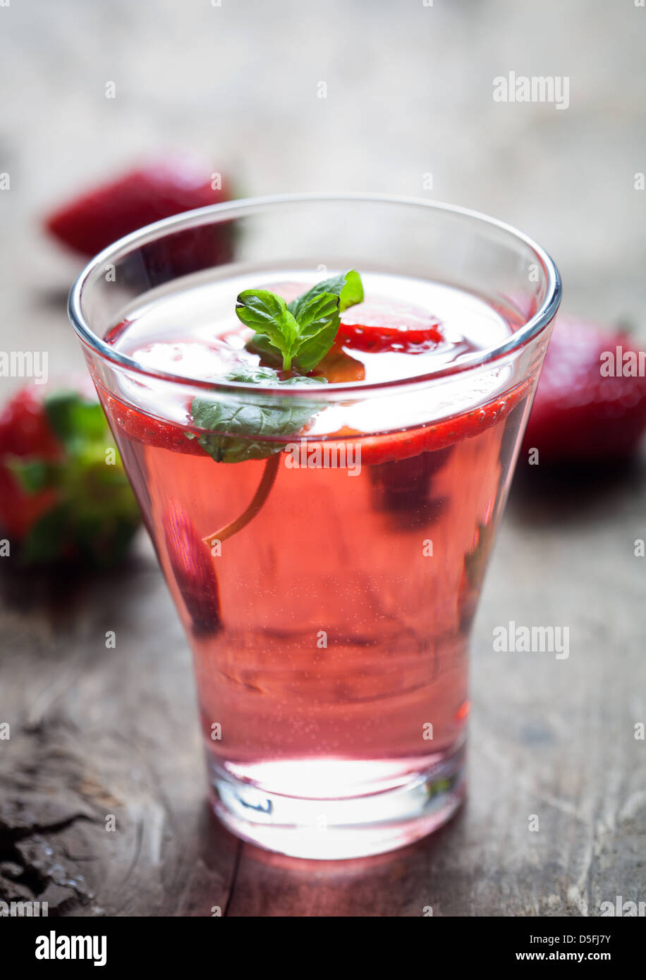 Cold summer drink with strawberries and mint  - Stock Image