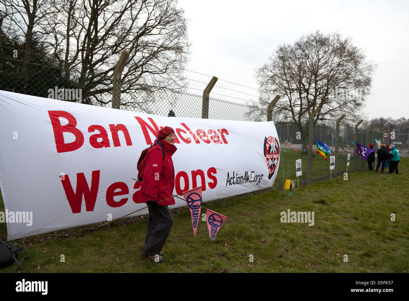 Aldermaston, Berkshire, UK. 1st April 2013.  Banners and posters were put up along the fence of the Atomic Weapons - Stock Image
