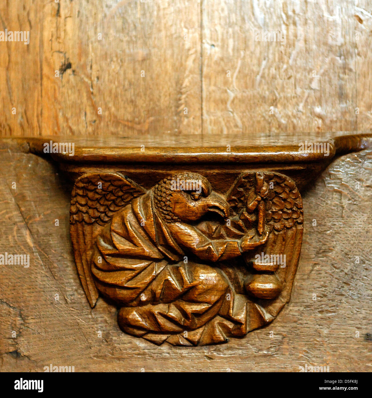 Misericord inside Lonlay l'Abbaye church, Orne, Normandy, France - Stock Image