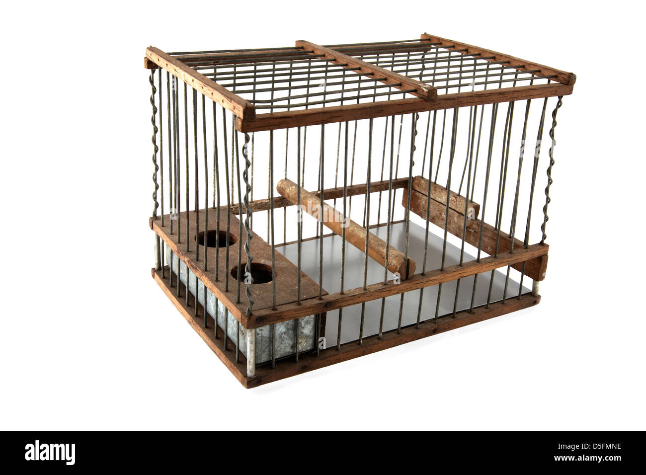 Cage containing birds, silhouetted against white background - Stock Image