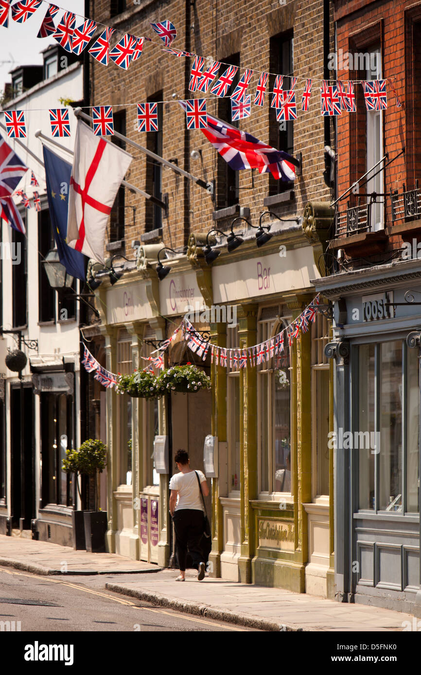 England, Berkshire, Eton High Street, shops and café decked with union flag bunting - Stock Image