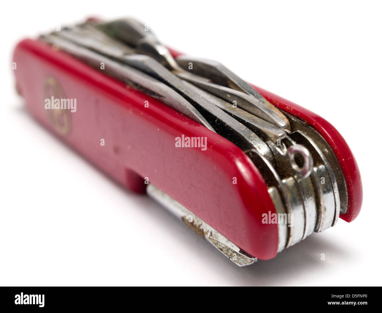 Red swiss army knife isolated on white background - Stock Image