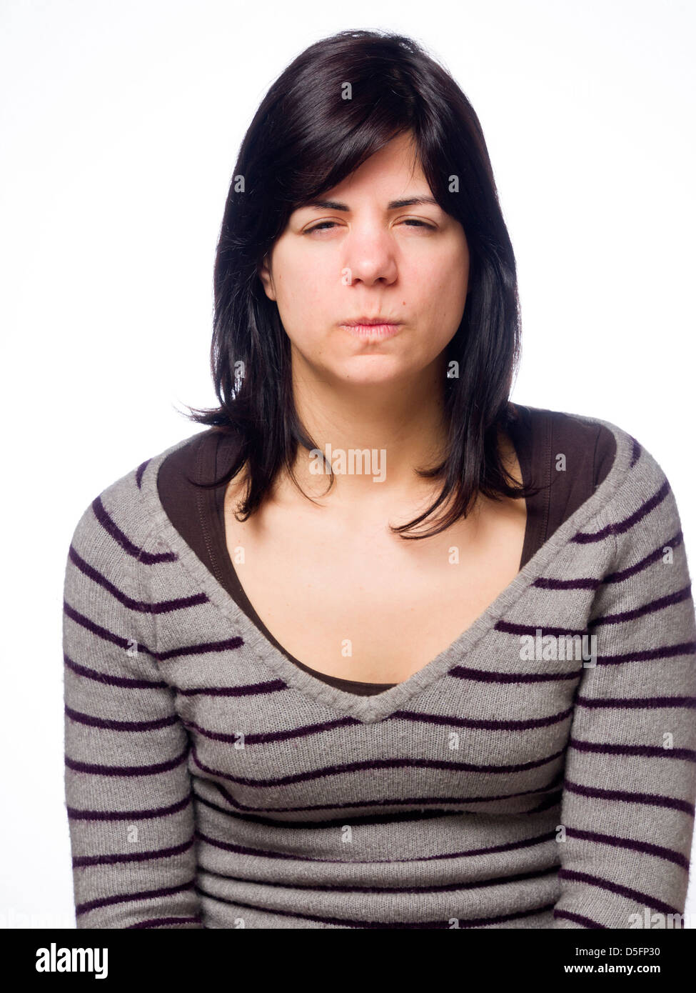 Angry young woman sulking - Stock Image