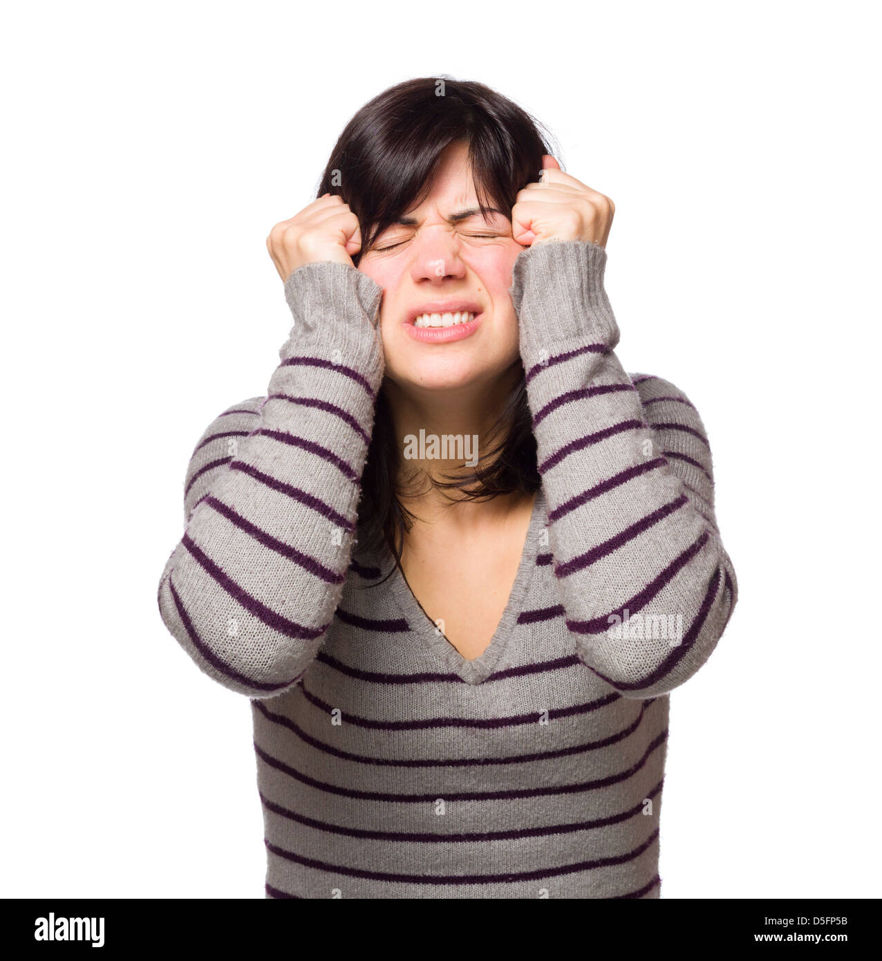 Frustrated young woman grimacing isolated on white background - Stock Image