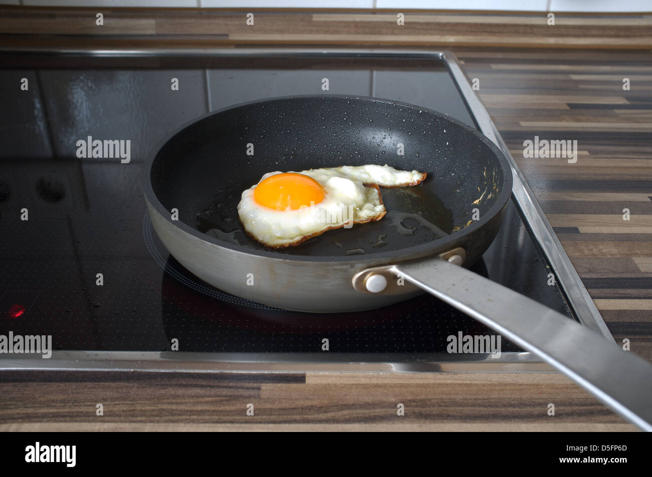 Fried egg in frying pan - Stock Image