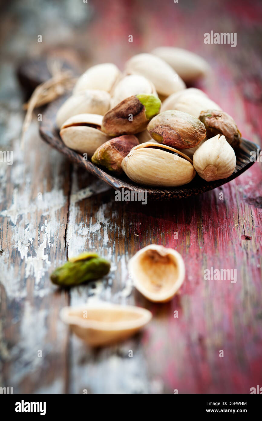 Bunch of pistachios with very selective focus - Stock Image