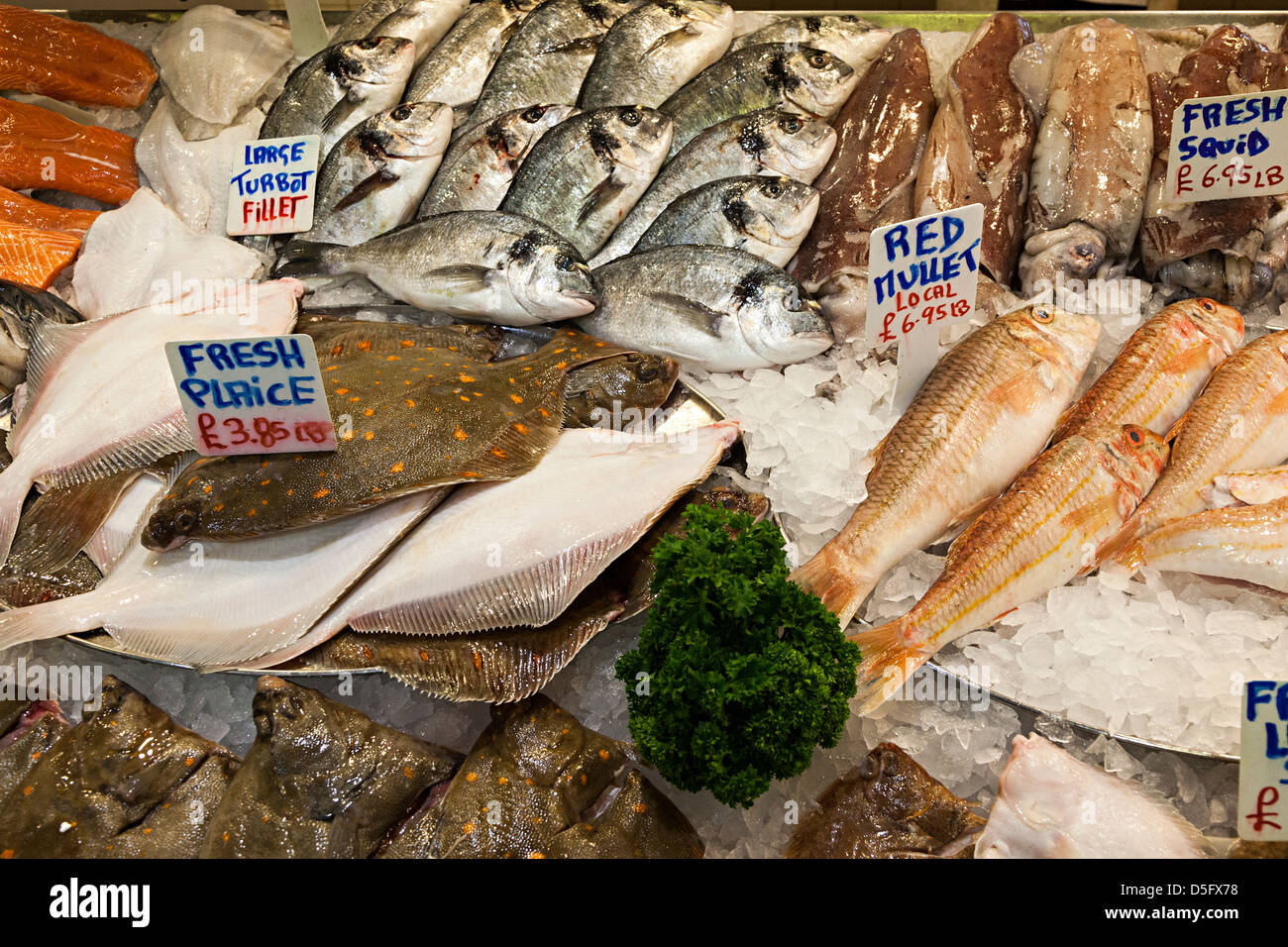 Fresh fish on sale in fishmonger, indoor market, St Helier, Jersey, Channel Islands, UK - Stock Image
