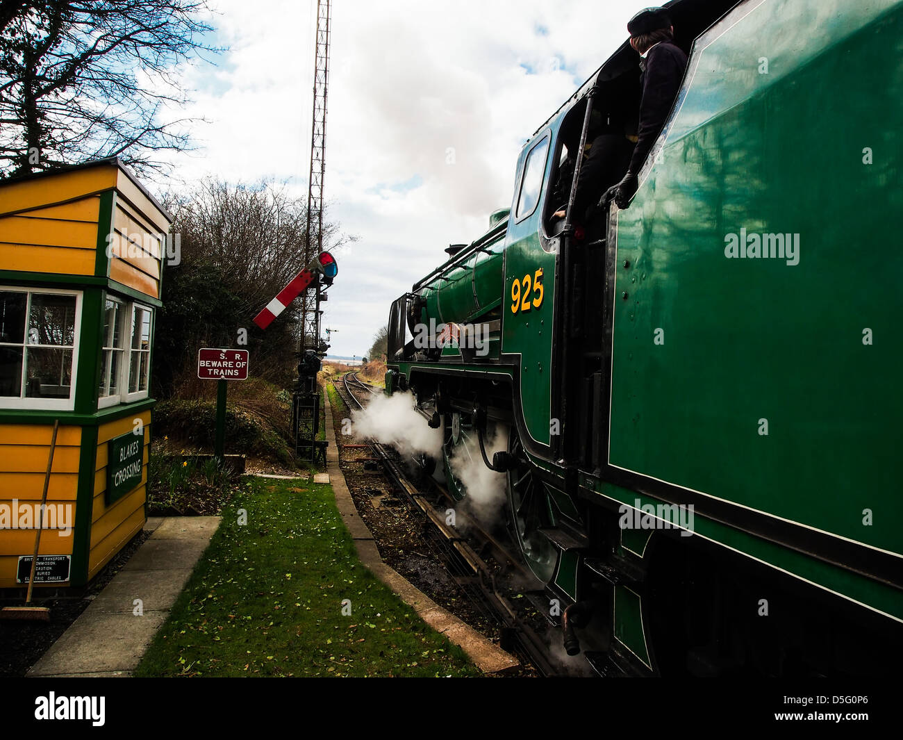 "Steam train, SOUTHERN RAILWAY SCHOOLS CLASS 4-4-0 No.925 ""Cheltenham"" passing a signal box on the Mid Hants Railway - Stock Image"