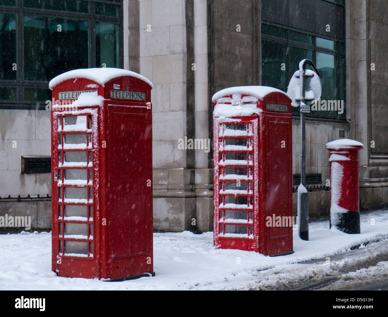 Telephone Kiosks and Post Box in the Snow, Sheffield. - Stock Image