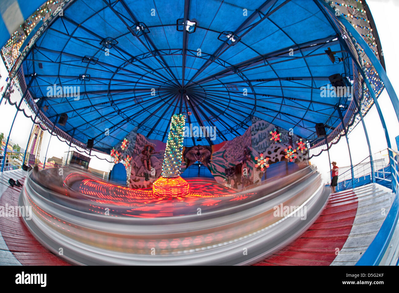 amusement ride, the spinner, in motion. - Stock Image