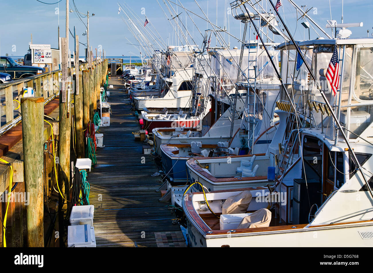Charter fishing boats docked in Rock Harbor, Orleans, Cape Cod, Massachusetts, USA - Stock Image