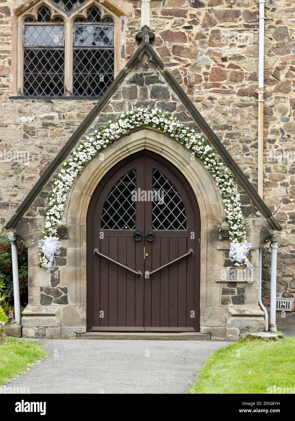 Church door with floral wedding garland All Saints Church Newtown Linford Leicestershire England UK & Church door with floral wedding garland All Saints Church Newtown ...