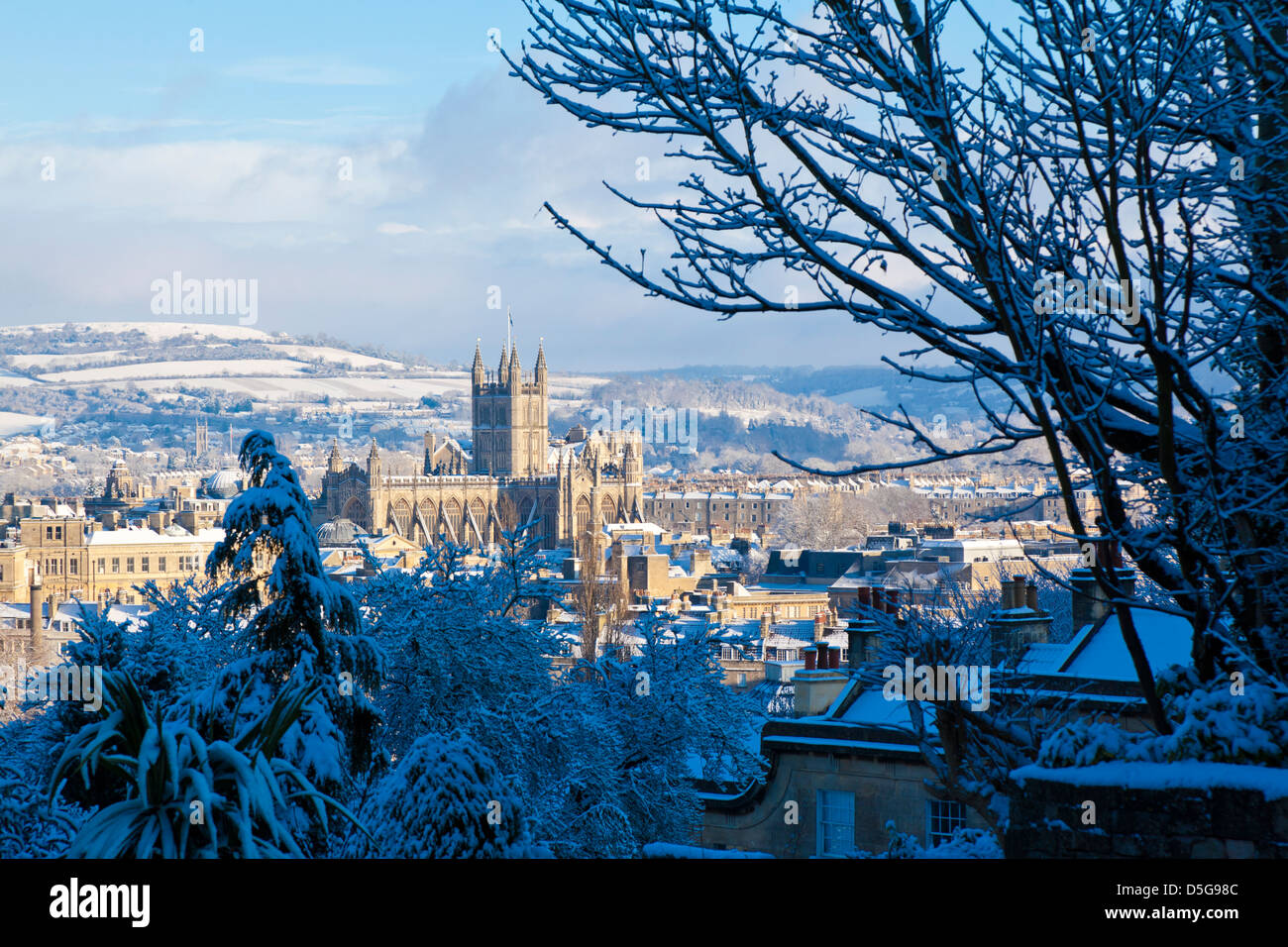 Winter scenic showing Bath Abbey surrounded by Georgian architecture and countryside in Bath, England, UK. - Stock Image