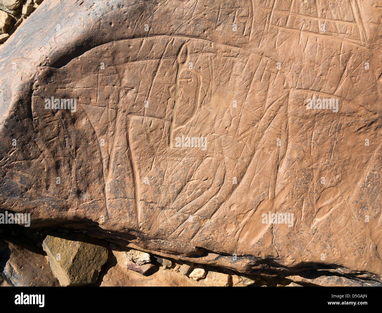 Prehistoric rock carvings at Oued Mestakou on the Tata to Akka road in Morocco. - Stock Image