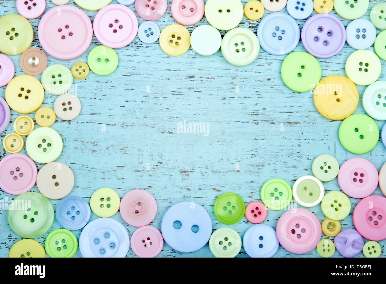 Pastel Color Buttons On A Blue Wooden Shabby Chic Background