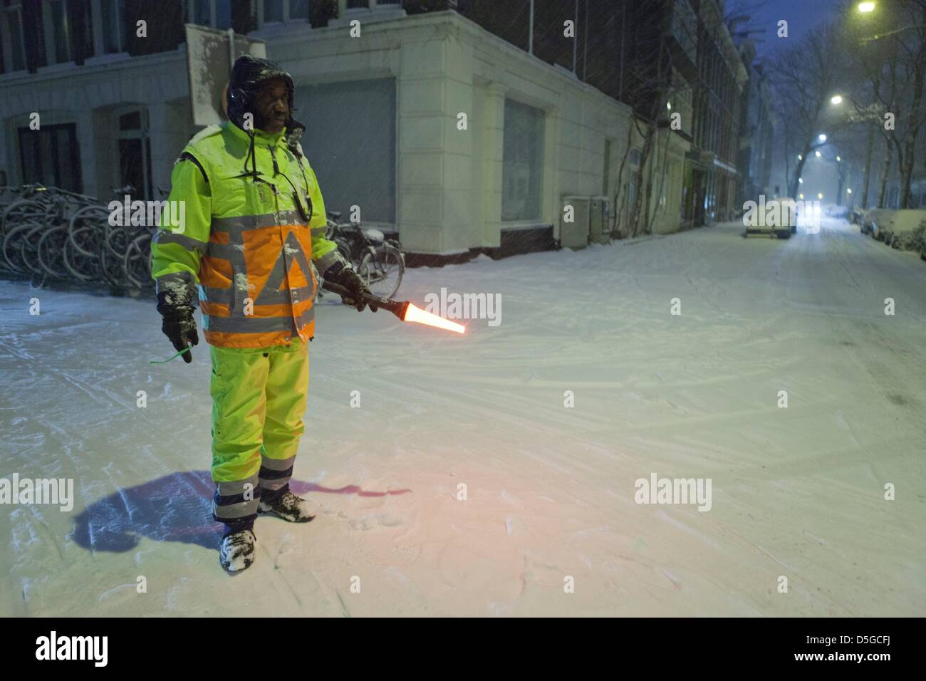 traffic controller in snowy amsterdam Stock Photo