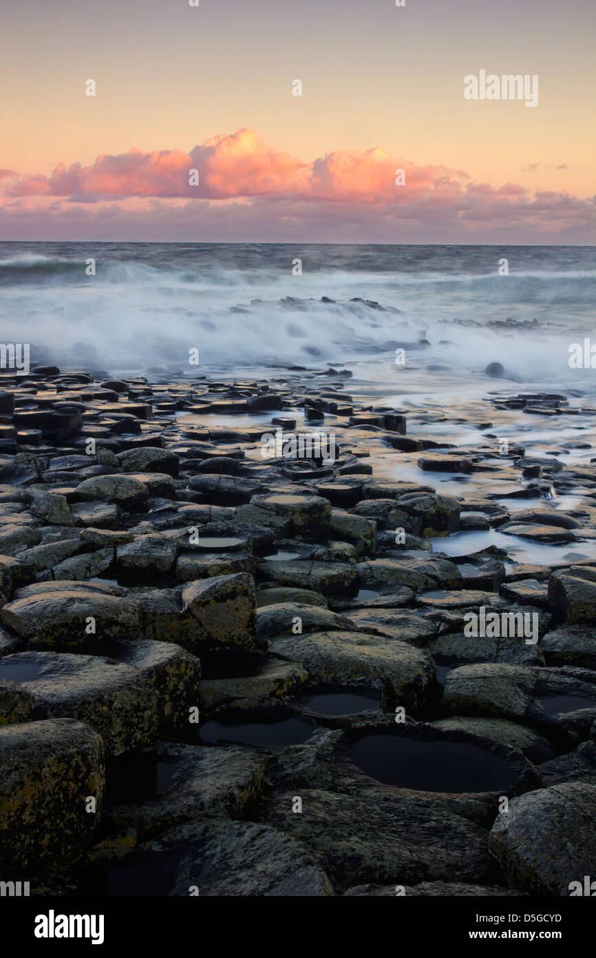 Sunrise tones at the famous Giant's Causeway - on the Antrim coast of Northern Ireland - UNESCO World Heritage Site. Stock Photo