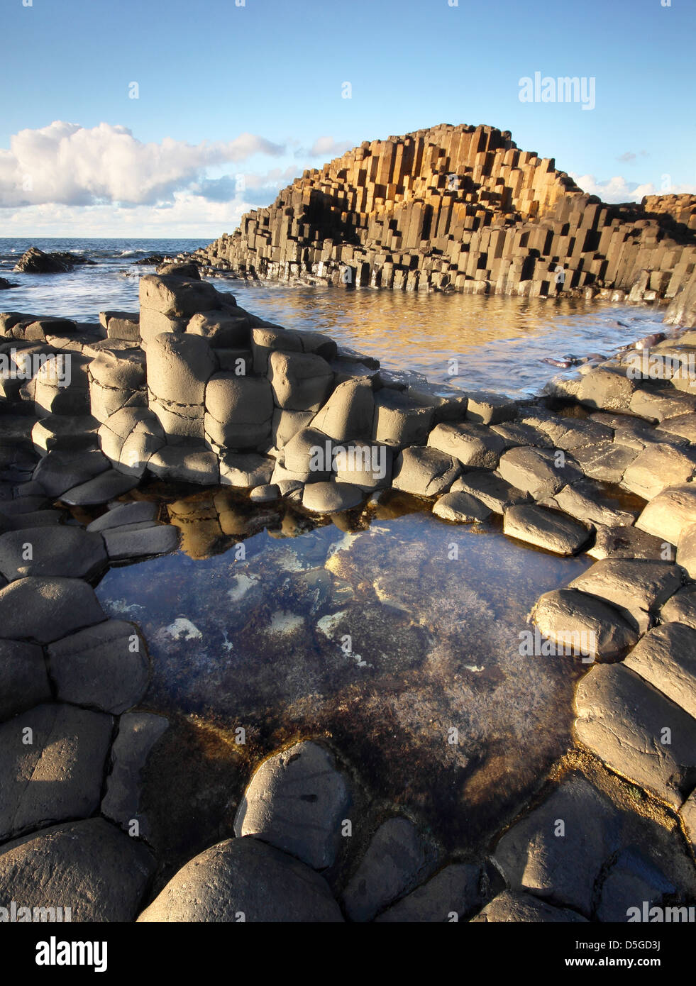 Beautiful sunny afternoon at the famous Giant's Causeway on the Antrim Coast of Northern Ireland - Stock Image