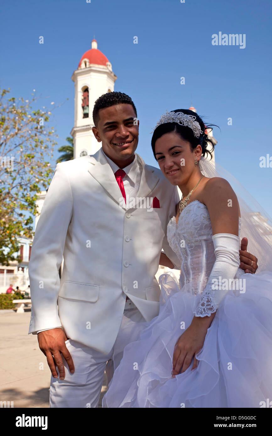 cuban wedding couple posing in front of the cathedral Cathedral de la Purisma Concepción in Cienfuegos, Cuba, - Stock Image