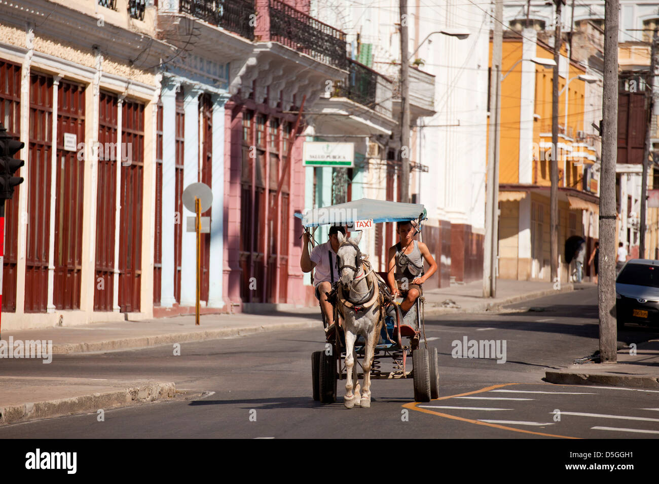 typical street and horse cart taxi in Cienfuegos, Cuba, Caribbean - Stock Image