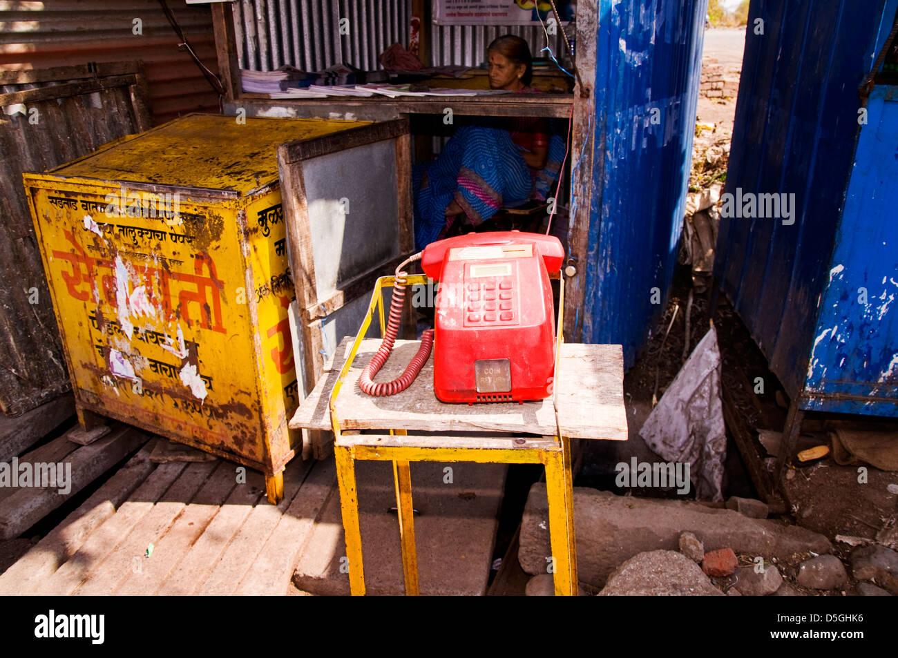 Public telephone kiosk stall in Paud Mulshi Valley Pune Maharashtra India - Stock Image