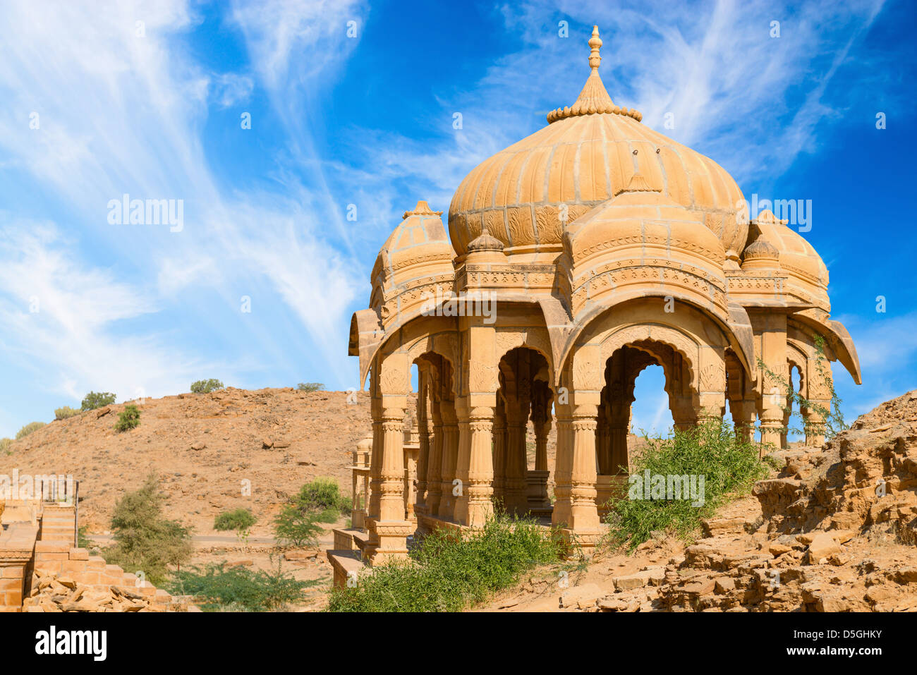 Chhatris on ruins of the royal cenotaphs of ancient Maharajas rulers in Bada Bagh, India - Stock Image