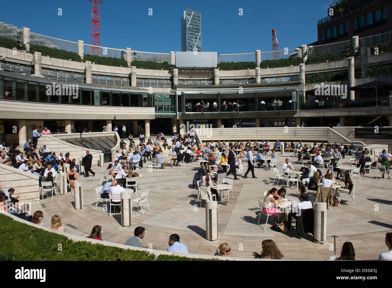 City workers enjoying an outdoor lunch at Broadgate and Exchange Square area close to Liverpool Street station, - Stock Image