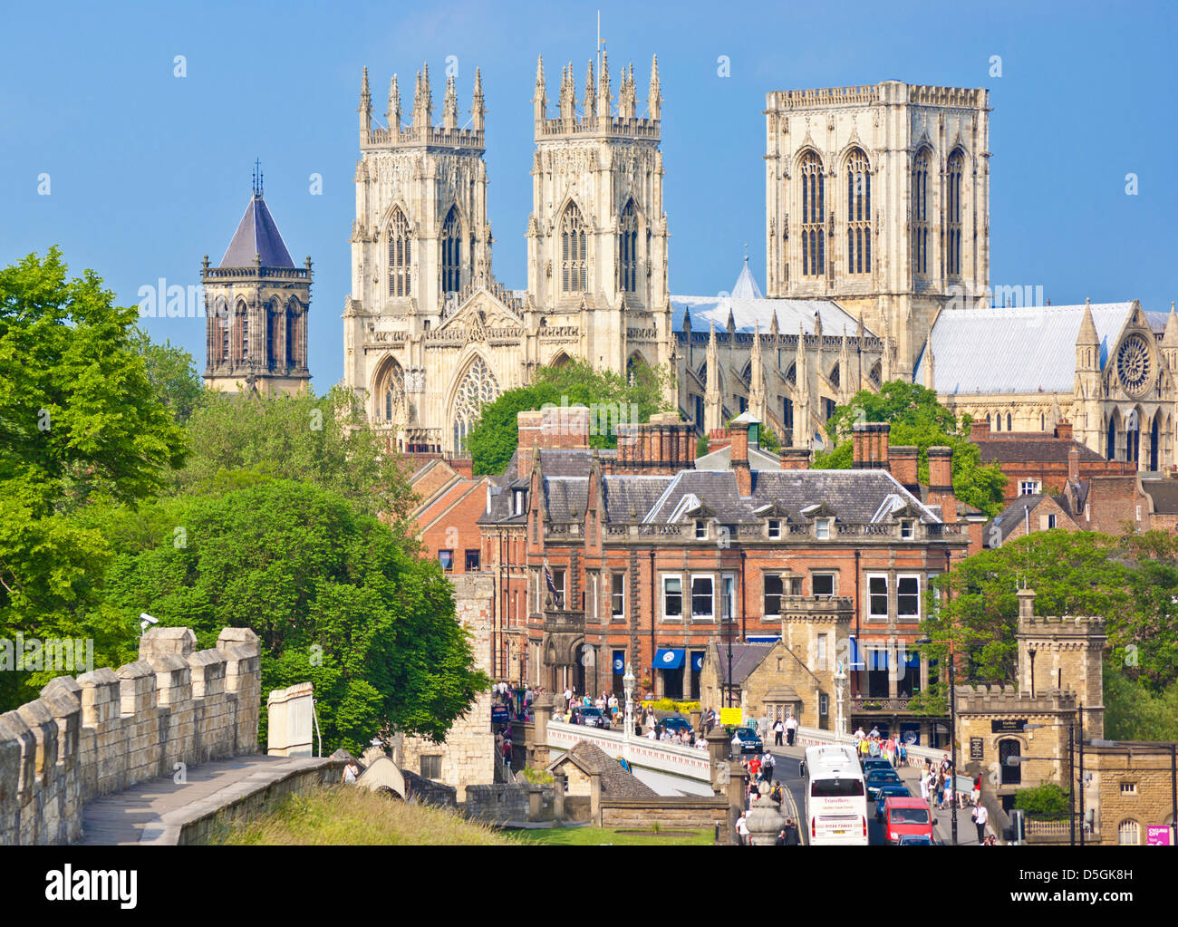 York Minster and a section of the historic york city walls along Station road York Yorkshire England UK GB EU Europe - Stock Image