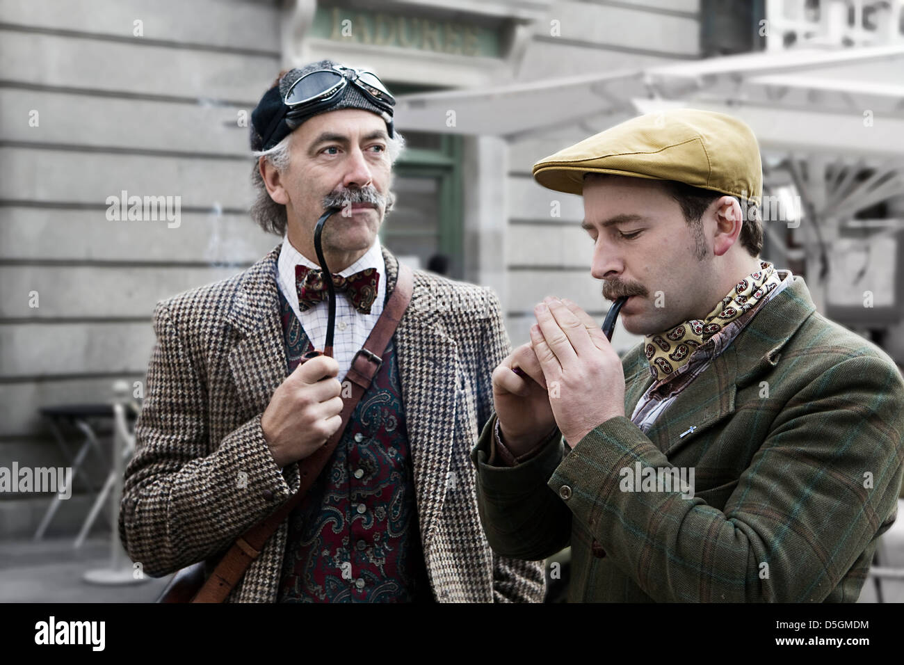 Two men smoking pipes. They are dressed in traditional British cycling  attires for the Tweed 4583344d4a1d