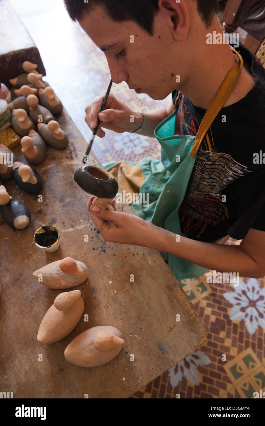 Cuba, Sancti Spiritus Province, Trinidad, artisan at pottery studio. - Stock Image