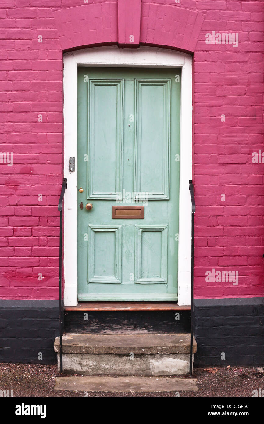 Green wooden front door of an english house Stock Photo