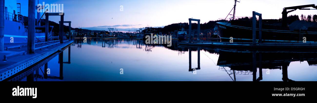 The fishing fleet is in port at the Kodiak harbor in Alaska. - Stock Image