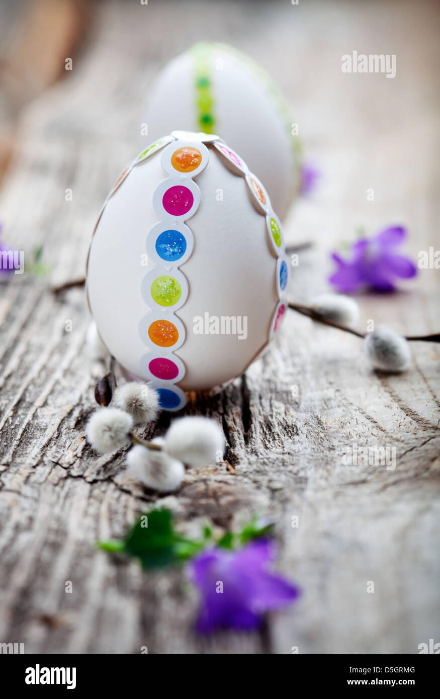 White easter eggs decorated with colorful stickers - Stock Image