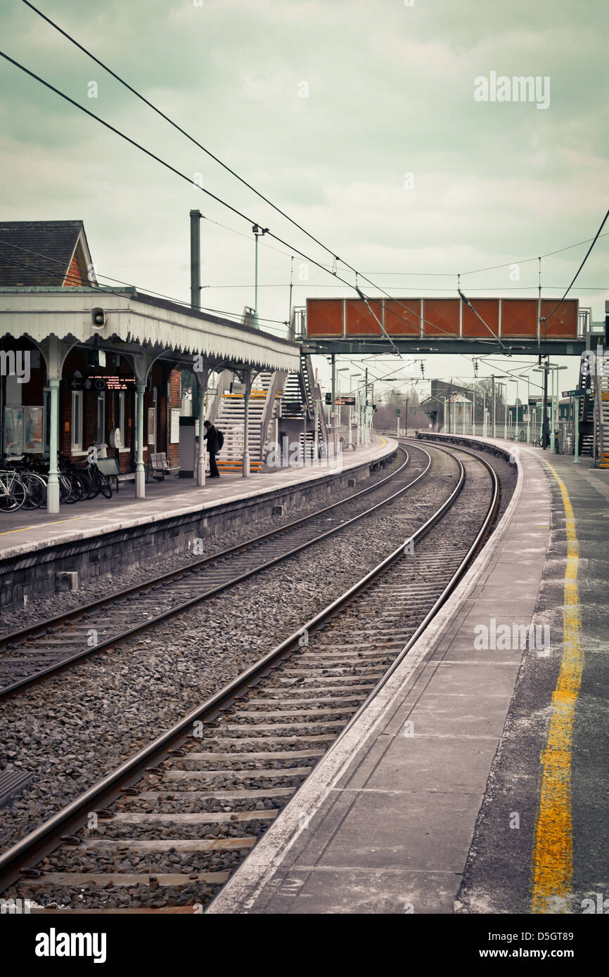 Railway station in the UK in muted tones - Stock Image