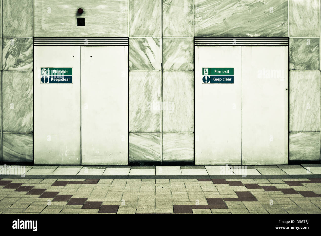 Two fire exit doors in a modern urban building Stock Photo