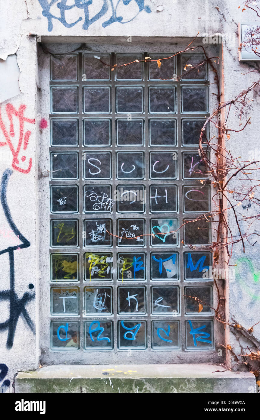 Tagged wall and windows, Antwerpen, Belgium Stock Photo