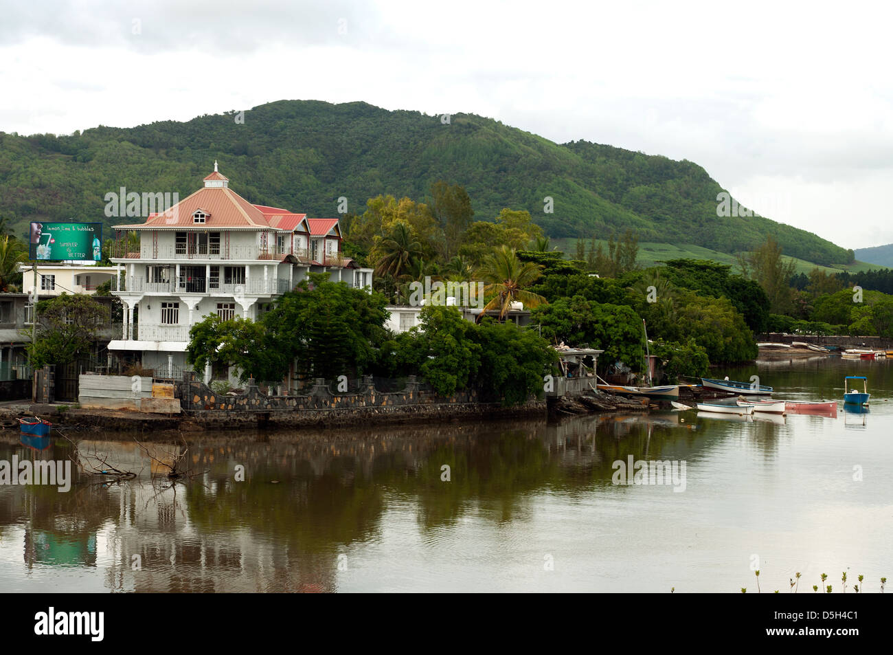 riviere de la chaux with boats and houses, mahebourg, mauritius - Stock Image