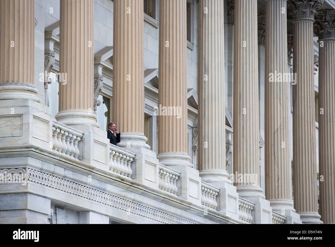 Senator John Hoeven (R-ND) speaks on a mobile phone the Senate Balcony at the U.S. Capitol in Washington on December - Stock Image