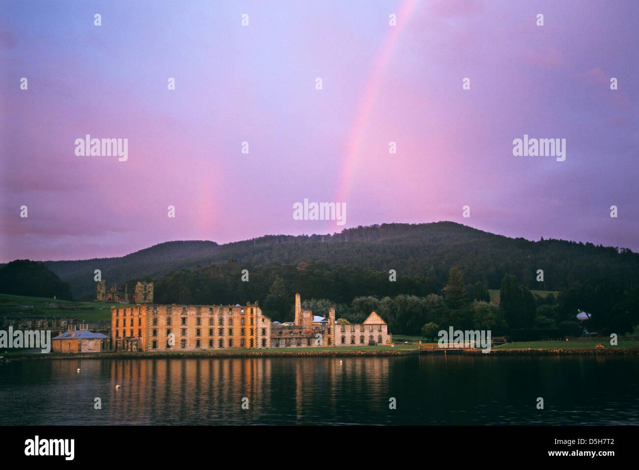 Australia, Tasmania, Tasman Peninsula, Port Arthur Historic Convict Site, rainbow over the concict Penitentiary - Stock Image