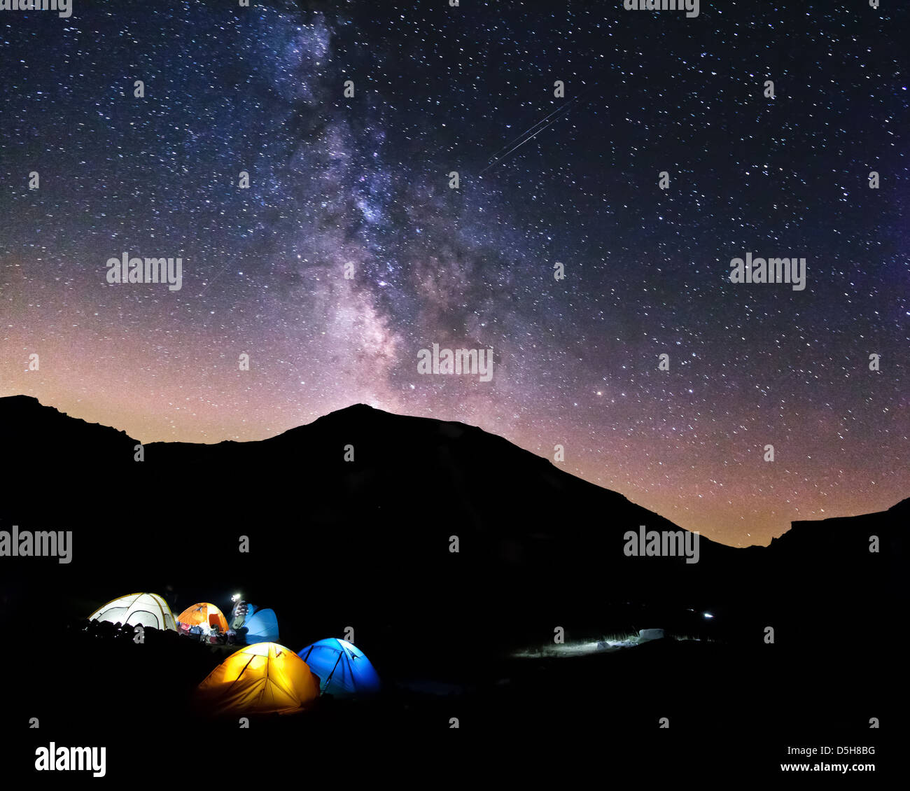 Night Sky and milky way over tents - Stock Image