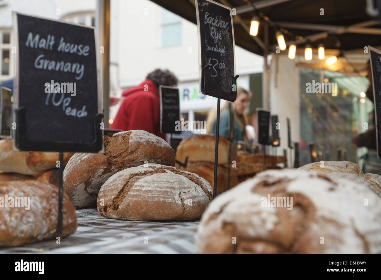 A local artisan bakery selling their loaves in a market in Basingstoke Town Centre - Stock Image