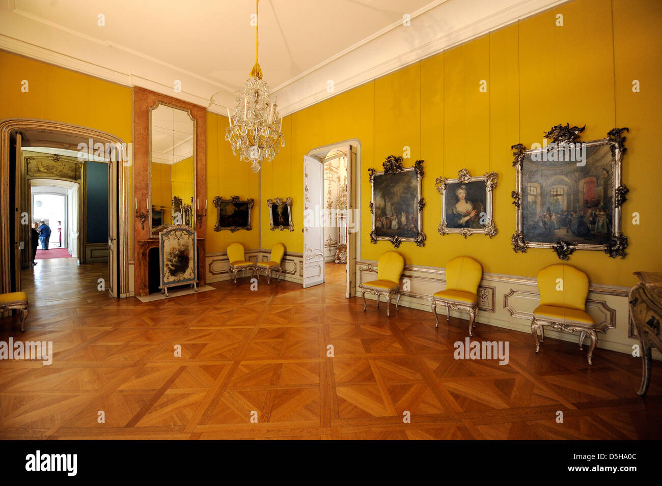 The yellow 'Atlas' chamber, part of the first apartment of Prussia's King Friedrich the Great, at Castle - Stock Image
