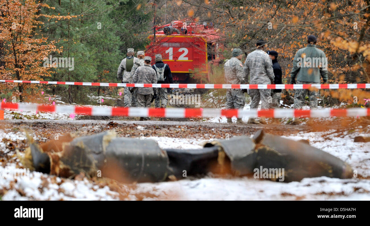 The scene of accident where the US Army's crashed UH-60 Black Hawk helicopter is examined in a wood between - Stock Image