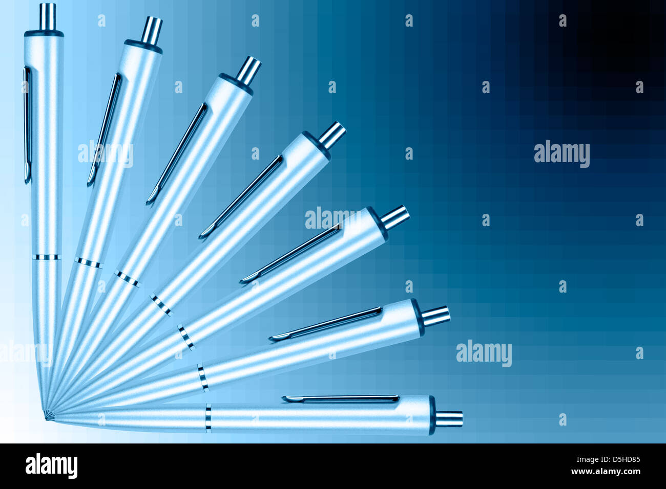 Fan of pens on a blue graduated background - Stock Image