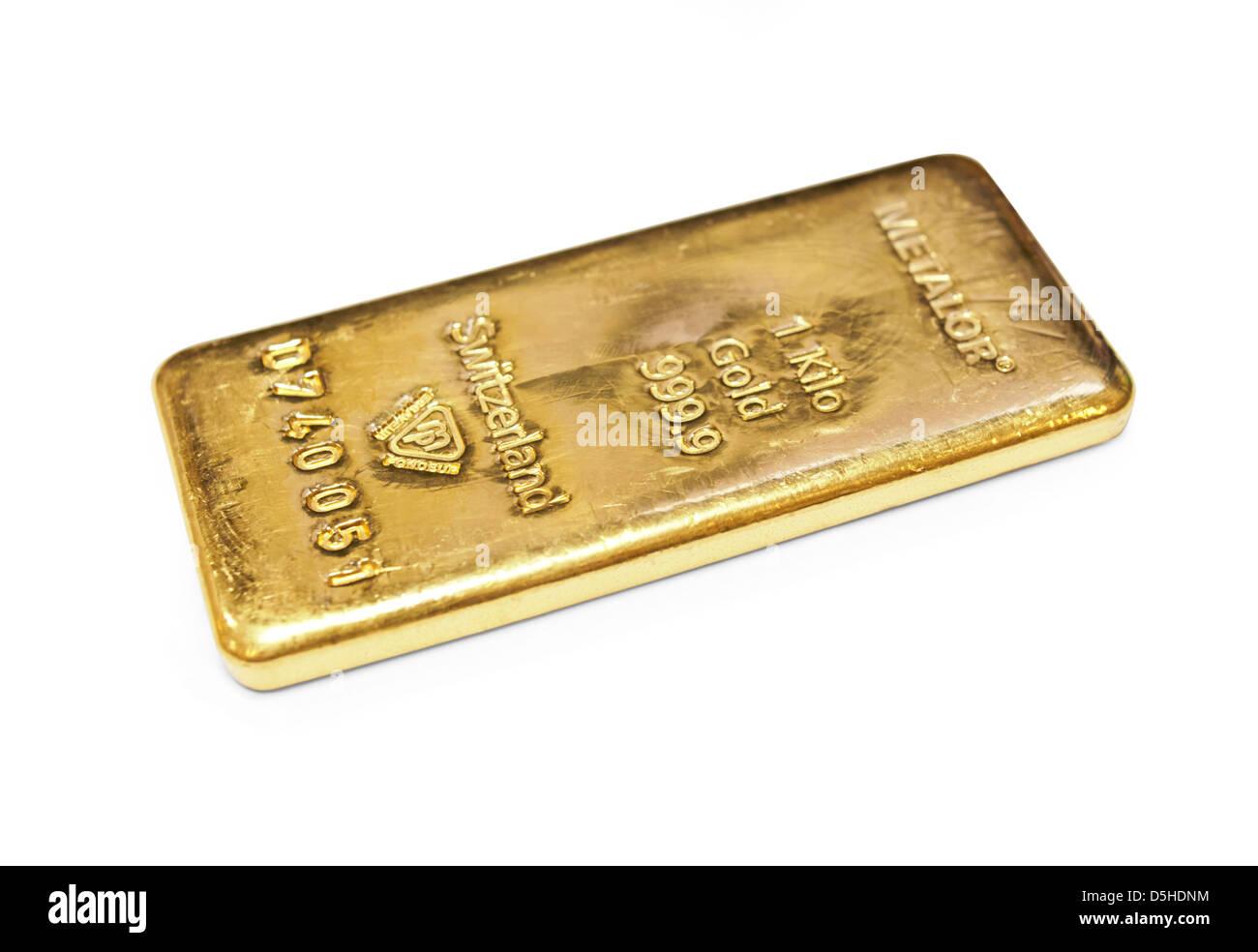One kilogram gold bar on white background - Stock Image