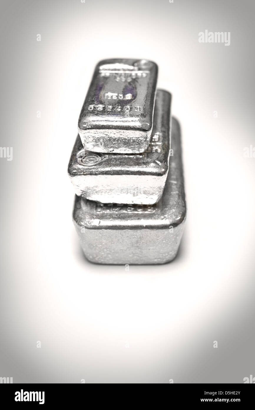 Silver bullion bars in a stack on white background - Stock Image