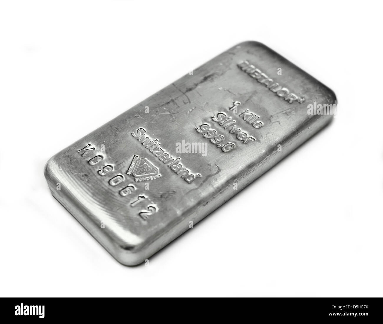 Silver bullion bar weighing one kilogram on plain white background - Stock Image