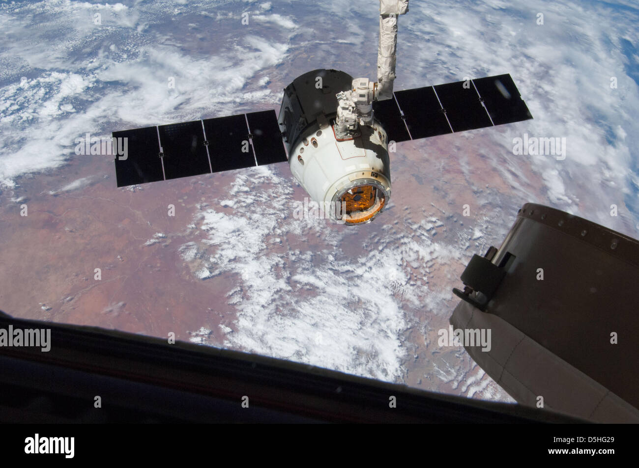 The SpaceX Dragon spacecraft is released after a three-week visit to theInternational Space Station March 26, 2013 - Stock Image