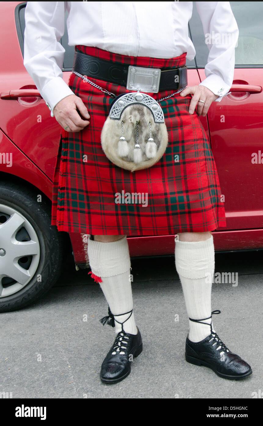 Scotsman wearing a kilt - Stock Image