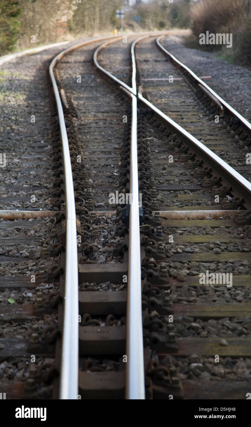 Two railway lines crossing at points near Woodbridge, Suffolk, England - Stock Image